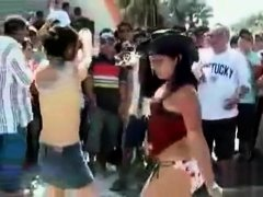 Chicks dance for a big audience of frat boys