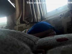 Girl lies down in couch upskirt