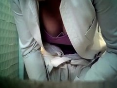 mature woman peeing in toilet
