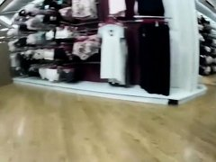 Woman bends over in a lingerie store