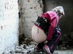 Athletic chick stopped to pee in ruins