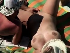 Gigantic fake tits of a topless babe