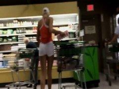 Sexy shopper in tight white shorts