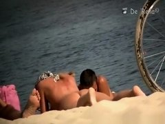 Voyeur at nudist beach films nude men and woman