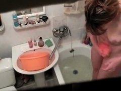 Woman spied in bathtub washing body