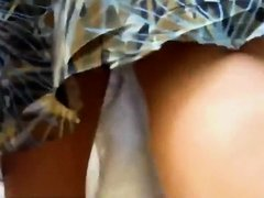 Lovable lady got a tiny thong under skirt