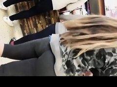 Long hair blonde teen in black leggings