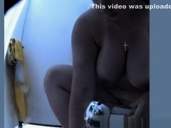 Chubby big tits mature spied in beach cabin