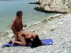Mature sex with his hot wife on the stony beach