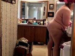 Fat mature woman doing her hygiene