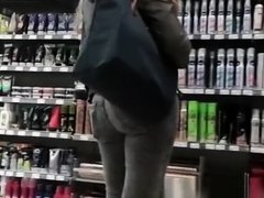 Tight jeans girl at supermarket