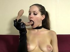 Goth girl in gloves and choker gives messy lipstick blowjob to dildo
