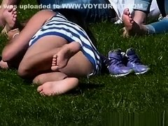 Look under the skirt of a girl lying on the grass