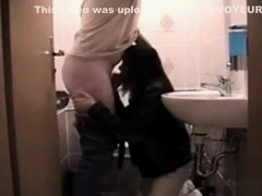 Brunette secretary blows her boss from the toilet floor