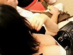 Woman deep cleavage on train