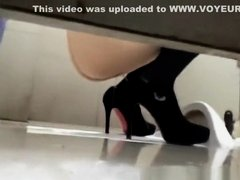 Woman in high heels caught in public toilet pissing