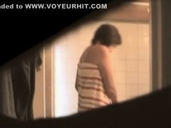 Busty aunt secretly filmed in the bathroom
