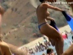 Sexy topless babe in a thong bikini