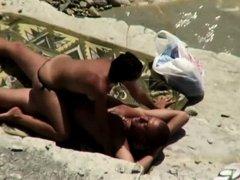 Woman initiates beach sex