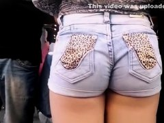 Tight jeans shorts stuffed in her butt crack