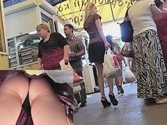 Legs and smooth butt upskirt at the market