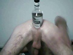 Huge bottle inside his asshole