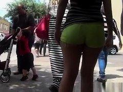 Latina teen in tight green shorts