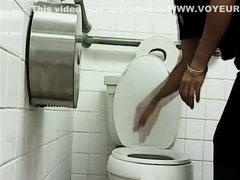 Woman pissing in public toilet
