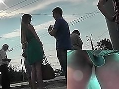 Upskirt voyeur scene at the bus stop with awesome lady
