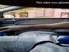 Guy plays with his dick inside car