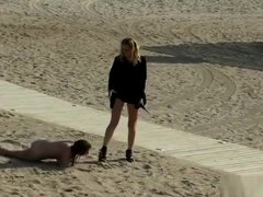 Lezdom disgrace and zapper on the beach