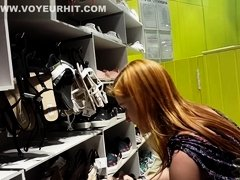 Candid Upskirt Shows Of Redhead Tries The Shoes On
