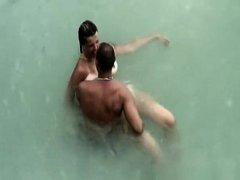 Tattooed nudist fucked in the water