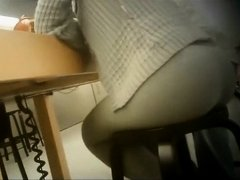 Hot woman sitting on a stool has her huge butt filmed