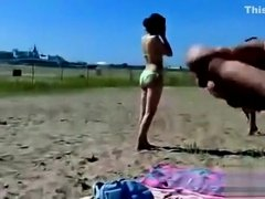 German pervert jerks off to women on topless beach
