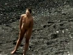Small tits girl is naked and sexy on the beach